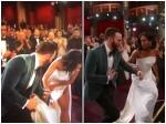 Oscars 2019 Chris Evans Helps Regina King On Stage