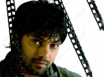 https://malayalam.filmibeat.com/img/2011/05/14-arya-actor.jpg