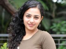 http://malayalam.filmibeat.com/img/2011/06/28-nithya-menon.jpg