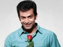 http://malayalam.filmibeat.com/img/2012/09/26-prithviraj-rose.jpg