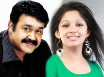 https://malayalam.filmibeat.com/img/2013/11/22-mohanlal-nyla-usha.jpg