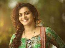 http://malayalam.filmibeat.com/img/2018/03/parvathy-1520043193.jpg