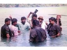 https://malayalam.filmibeat.com/img/2019/03/santhosh-sivan-1552649376.jpg